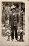 Photography: Childhood-Youth, Boy in Suit at Gravesite
