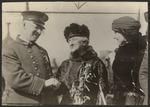 Policeman welcoming Louisine Havemeyer and Vida Milholland on arrival of the Prison Special at Syracuse, New York