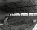 Cecil Humphreys checking on new gymnasium construction at Memphis State College, 1951