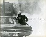 Policeman wearing a gas mask, Memphis, 1968