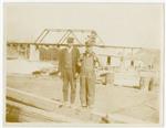 Two men at railroad yard near Meridian, Mississippi
