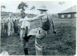 Ex-POW Jack Gates kicks a Japanese guard, 1945