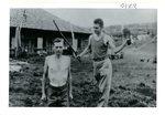 Lamar Gillett and Jack Gates demonstrate Japanese punishment, 1945