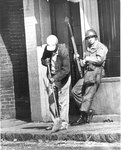 Cleaning up broken glass on Vance Avenue, Memphis, 1968