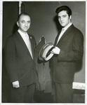 Elvis Presley with Arthur Groom of Loew's State Theater, 1957