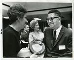 Dr. Hollis F. Price, president of LeMoyne-Owen College, receives an award, 1968